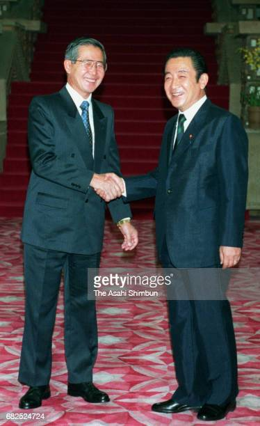 Peruvian President Alberto Fujimori and Japanese Prime Minister Ryutaro Hashimoto shake hands prior to their meeting at Hashimoto's official...