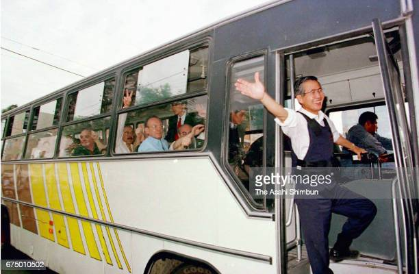 Peruvian President Alberto Fujimori celebrates on the bus carrying released hostages after special force units bursting into the Japanese...