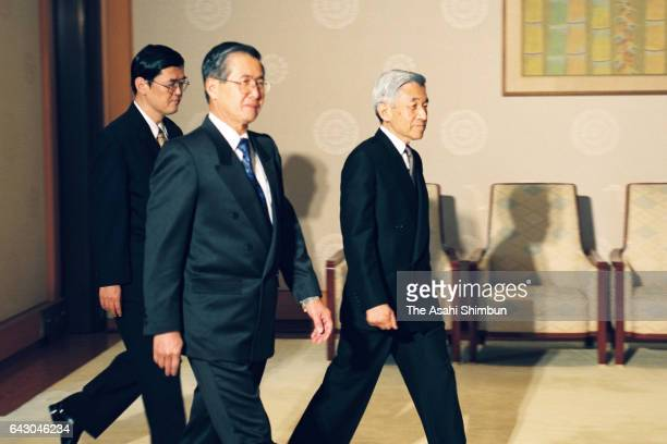 Peruvian President Alberto Fujimori is escorted by Emperor Akihito during their meeting at the Imperial Palace on July 1 1998 in Tokyo Japan
