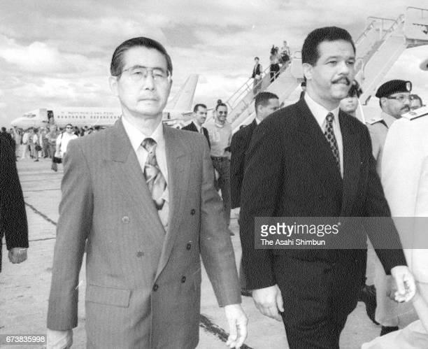 Peruvian President Alberto Fujimori is welcomed by Dominican Republic President Leonel Fernandez at Las Americas International Airport on March 2...