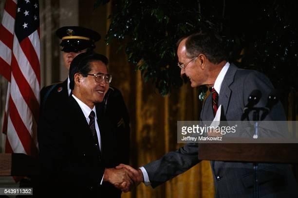 Peruvian President Alberto Fujimori meets with American President George Bush at the White House