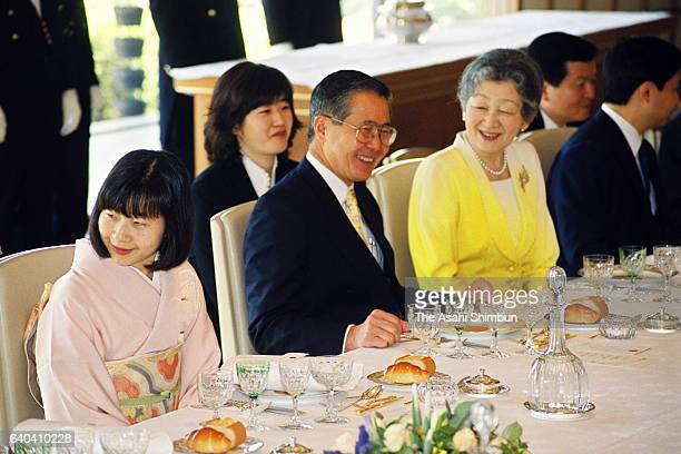 Peruvian President Alberto Fujimori talks with Empress Michiko during the luncheon at the Imperial Palace on May 21, 1999 in Tokyo, Japan.