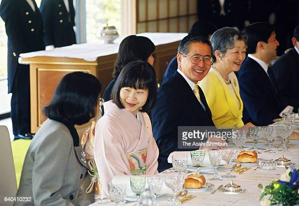 Peruvian President Alberto Fujimori talks with Empress Michiko while Prinecss Sayako talks with a guest during the luncheon at the Imperial Palace on...