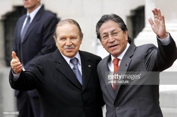 Peruvian President Alejandro Toledo and Algeria's President Abdelaziz Bouteflika pose for photographers at the Presidential Palace in Lima 18 May...