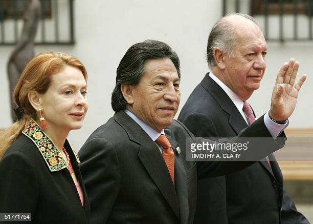 Peruvian President Alejandro Toledo and his wife Ellianne Karp is greeted by Chilean President Ricardo Lagos as he arrives at the La Moneda Palace in...