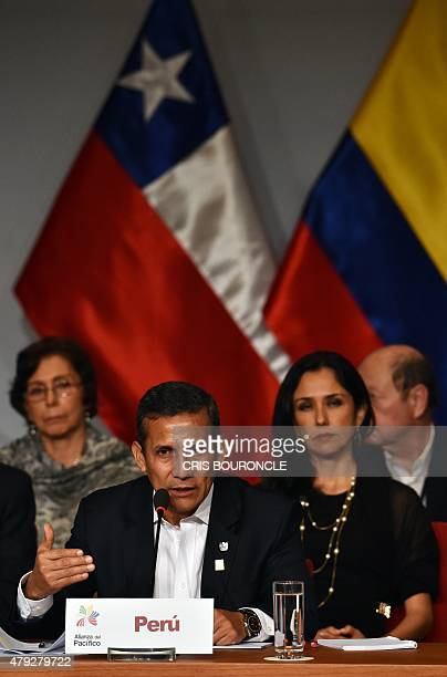 Peruvian President Olanta Humala flanked by his wife Nadine Heredia speaks during the inauguration of the 10th Pacific Alliance Summit in Paracas 250...