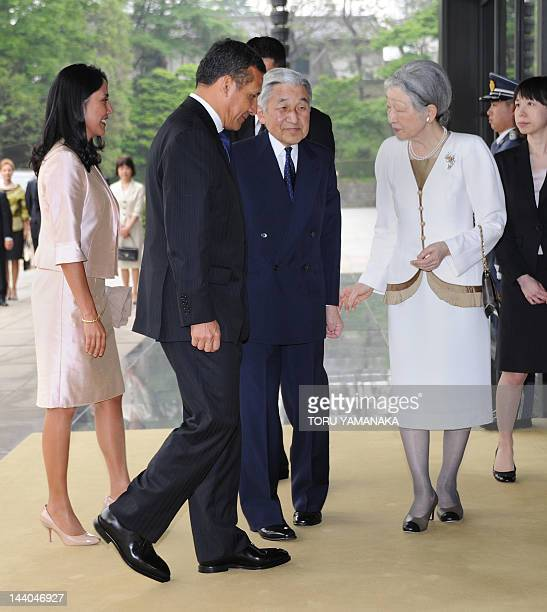 Peruvian President Ollanta Humala and his wife Nadine Heredia are welcomed by Japanese Emperor Akihito and Empress Michiko when they arrive at the...