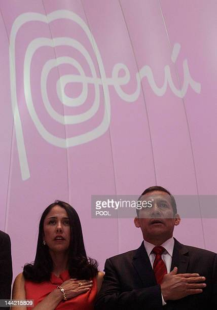 Peruvian President Ollanta Humala and his wife Nadine Heredia sing the national anthem during the opening ceremony of the Peru Pavilion at the Expo...