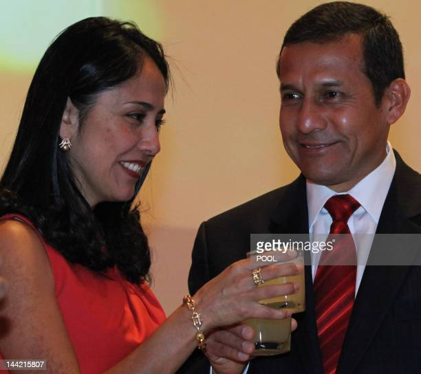 Peruvian President Ollanta Humala and his wife Nadine Heredia toast during the opening ceremony of the Peru Pavilion at the Expo 2012 in Yeosu, a...