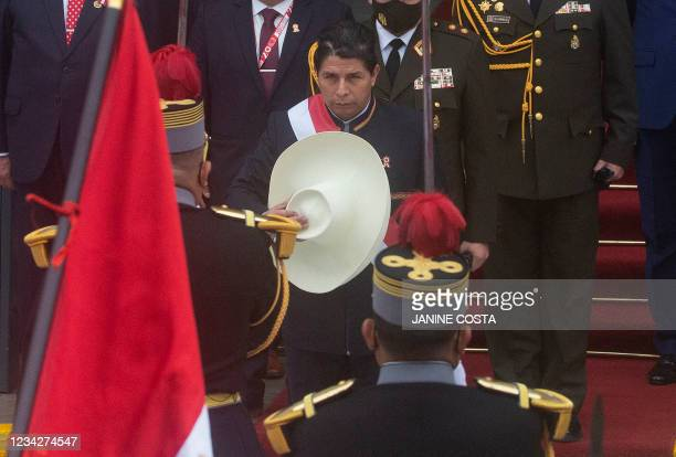 Peruvian President Pedro Castillo salutes the national flag as he exits the Congress after his inauguration ceremony in Lima, on July 28, 2021. -...