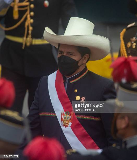 Peruvian President Pedro Castillo wears the presidential sash as he exits the Congress after his inauguration ceremony in Lima, on July 28, 2021. -...