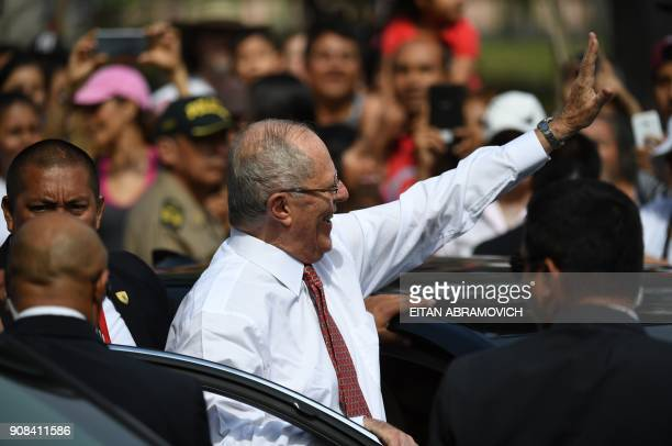 Peruvian President Pedro Pablo Kuczynski gets out of his car to greet people waiting to see Pope Francis pass by on his way to the Las Palmas air...