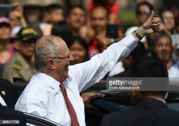 Peruvian President Pedro Pablo Kuczynski gives his thumb up to people waiting to see Pope Francis pass by on his way to the Las Palmas air base in...