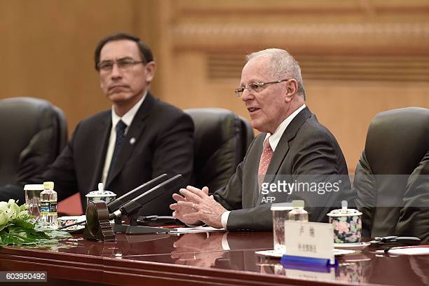 Peruvian President Pedro Pablo Kuczynski speaks during a meeting with Chinese President Xi Jinping at the Great Hall of the People in Beijing on...