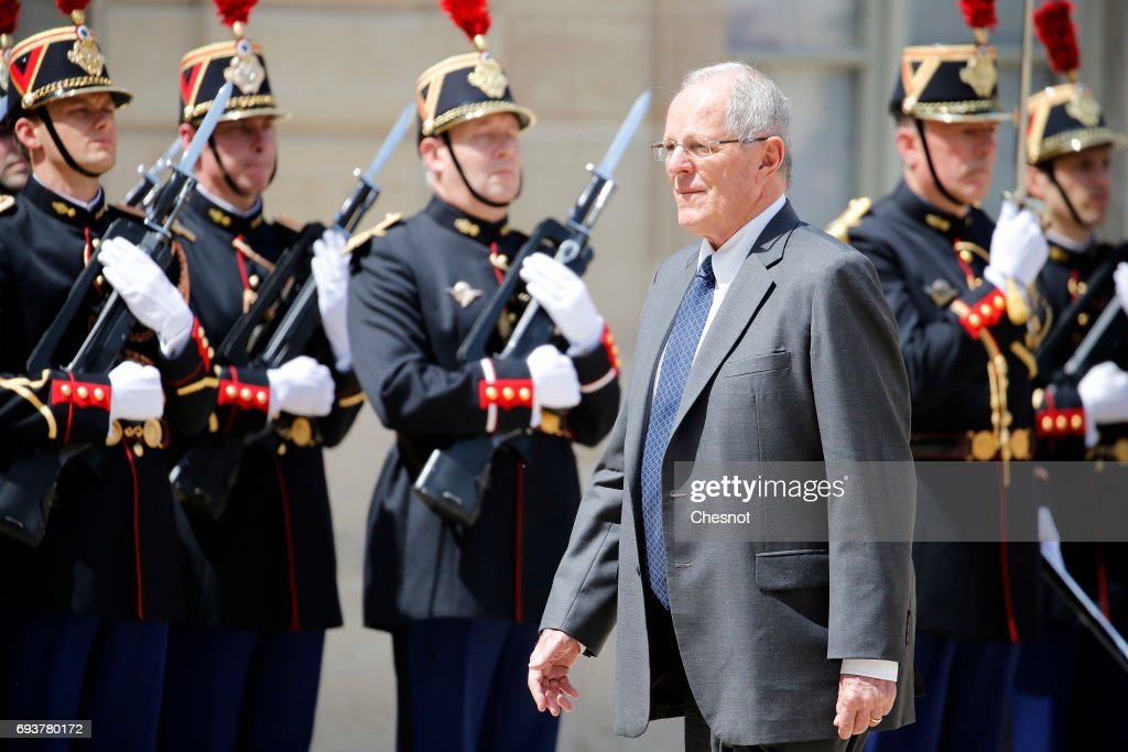 Peruvian President Pedro Pablo Kuczynski walks past Republican Guards as he arrives before his meeting with French President Emmanuel Macron at the Elysee Presidential Palace on June 08, 2017 in Paris, France. Kuczynski is on an official visit to France before going to Spain.