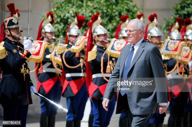 Peruvian President Pedro Pablo Kuczynski walks past Republican Guards as he arrives before his meeting with French President Emmanuel Macron at the...