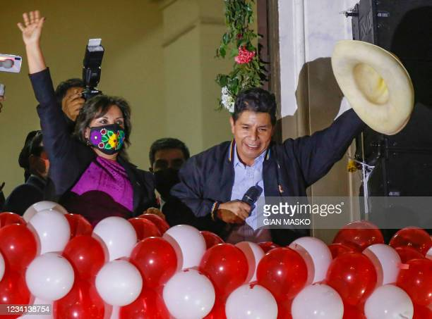 Peruvian President-elect Pedro Castillo and his running mate Dina Boluarte greet their supporters during a celebration at the Peru Libre...