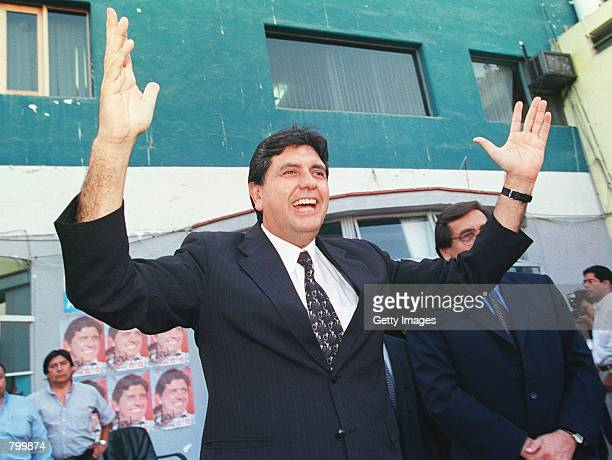 Peruvian presidential candidate Alan Garcia celebrates after learning the results of the first round of presidential elections April 9 2001 in Lima...