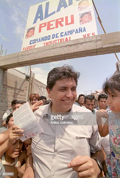 Peruvian presidential candidate Alan Garcia greets supporters February 26 2001 during a visit to the district of El Callao north of Lima Peru Garcia...