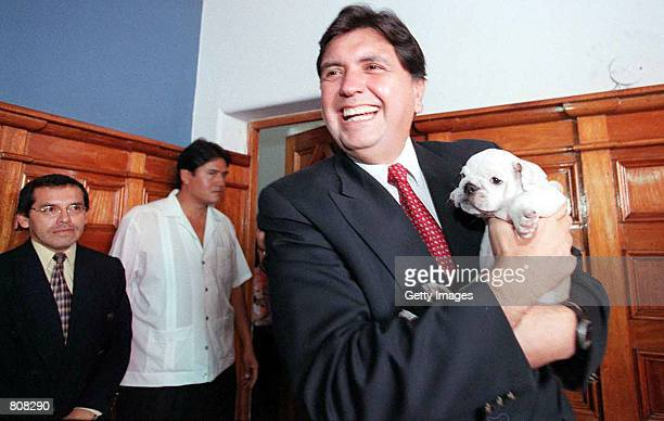 Peruvian presidential candidate Alan Garcia holds his new bulldog puppy during a press conference April 24 2001 in Lima Peru Garcia who is a former...