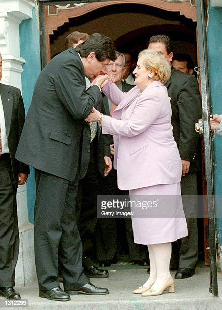 Peruvian presidential candidate Alan Garcia kisses the hand of former US Secretary of State Madeleine Albright June 2 2001 in the doorway of...