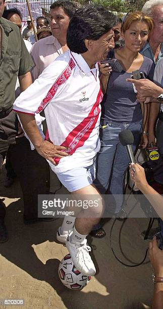 Peruvian presidential candidate Alejandro Toledo dressed in a Peruvian national soccer league uniform talks with reporters March 29 2001 after a...