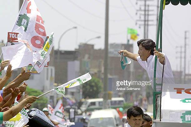 Peruvian presidential candidate Alejandro Toledo greets supporters during a visit to the Villa Maria del Triunfo shanty town February 26 2001 outside...