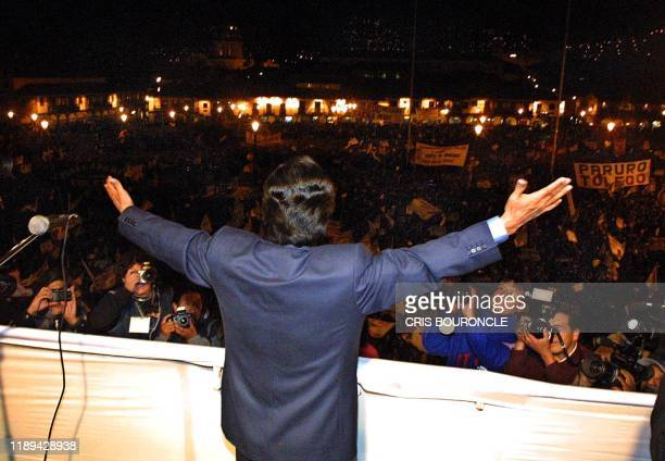Peruvian presidential candidate Alejandro Toledo of the Peru Posible Party acknowledges supporters at a rally 31 May 2001 in Cuzco Peru Toledo will...