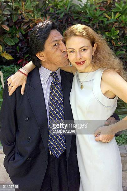Peruvian presidential candidate Alexander Toledo of the opposition party known as Peru Possible kisses his wife, Eliane Karp 21 March 2000 in the...