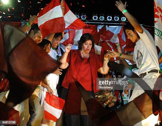 Peruvian presidential candidate for National Unity Party Lourdes Flores dances with a group of young supporters during her closing campaign in Lima...