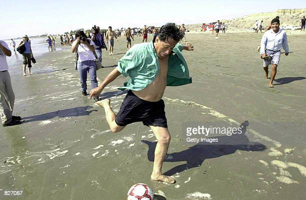 Peruvian Presidential frontrunner Alejandro Toledo plays soccer on a beach in the northern city of Piura March 1 2001 during his long tour across the...