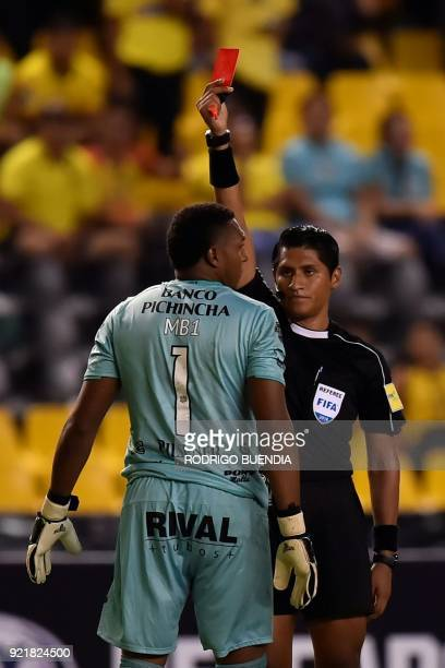 Peruvian referee Michael Espinoza shows the red card to Ecuador´s Barcelona goalkeeper Maximo Banguera during their 2018 Copa Sudamericana football...
