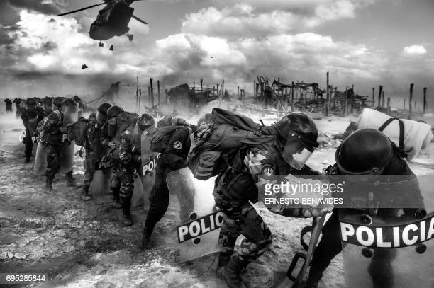 TOPSHOT Peruvian riot police await for their transport helicopters to land to pick them up by at the end of an interdiction operation in the illegal...