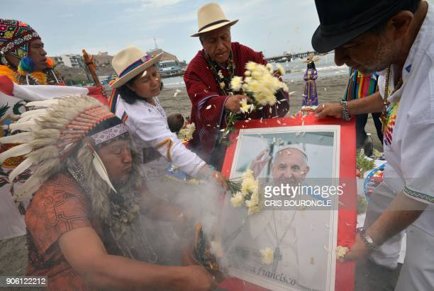 Peruvian shamans -indigenous witch doctors or priests- perform a ritual of spiritual support to welcome and protect Pope Francis, on January 17, 2018...