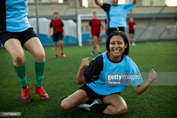 peruvian soccer player celebrates scoring a goal in a competition. - soccer competition stock pictures, royalty-free photos & images