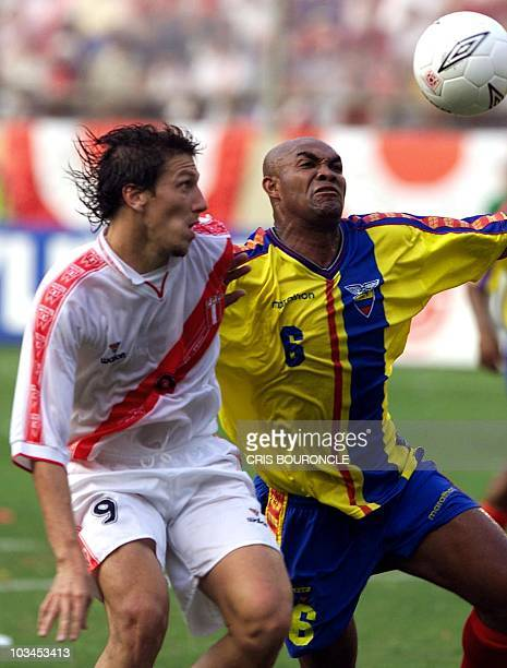 Peruvian soccer player Flavio Maestri fights for the ball with Ecuadorean player Raul Guerron 02 of June of 2001 in Lima in a qualifying match for...
