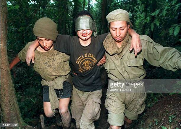 Peruvian soldier injured by a mine explosionis evacuated by two comrades 17 February in a stretch of unmarked border with Ecuador in the Amazon...