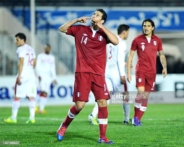 Peruvian team captain Claudio Pizarro clebrates his goal during a friendly football match against Tunisia on February 29 2012 in El Menzh Olympic...
