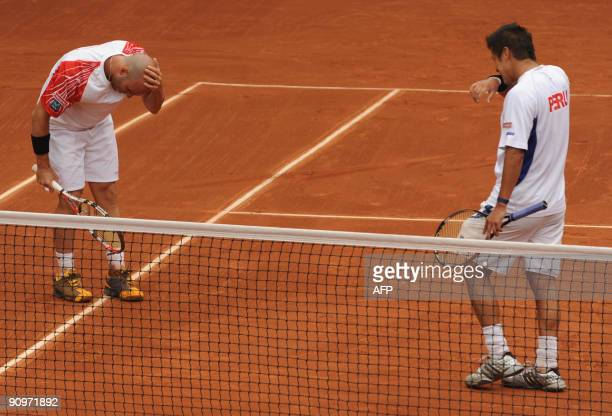 Peruvian tennis player Ivan Miranda and his partner Luis Horna gesture after missing a point in their Davis Cup's Americas Zone Group 1 Doubles match...