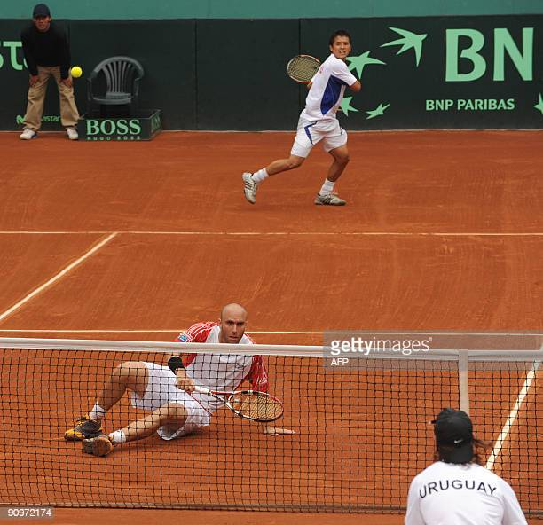 Peruvian tennis player Luis Horna falls to the ground while his partner Ivan Miranda goes for the ball during their Davis Cup's Americas Zone Group 1...