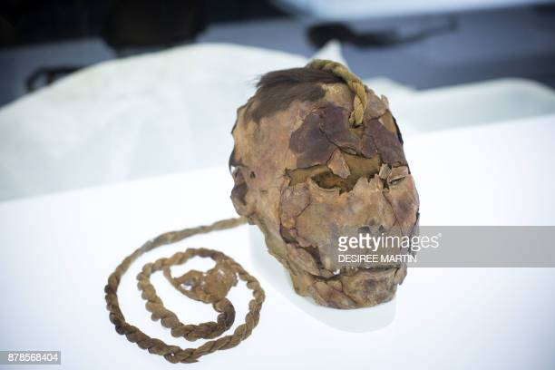A Peruvian trophy head from the collection of the Archaeological Museum of Tenerife is prepared to be displayed at the 'Athanatos Immortal Death and...