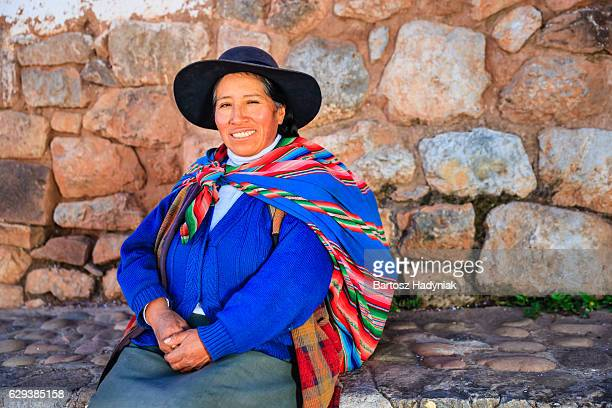 Peruvian woman at Inca ruins, The Sacred Valley, Peru