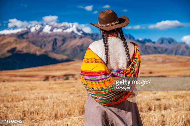 peruvian woman in national clothing looking at andes, the sacred valley - quechua people stock pictures, royalty-free photos & images