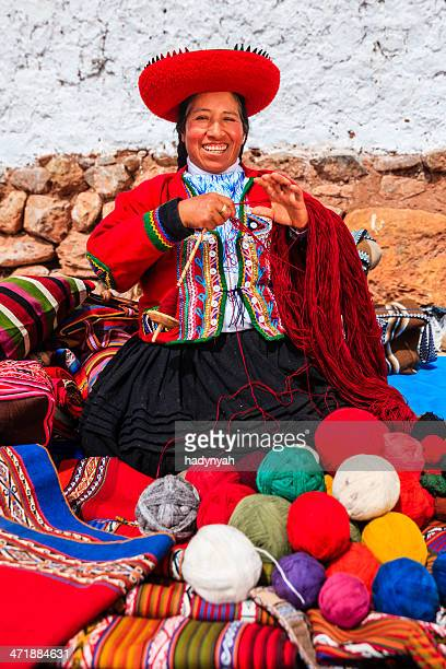 peruvian woman selling souvenirs at inca ruins, sacred valley, peru - quechua people stock pictures, royalty-free photos & images