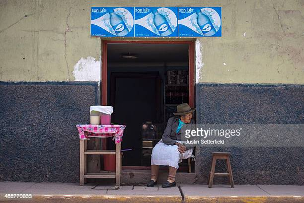 Peruvian woman sells cold drinks in the Incan city of Cusco on January 14 2014 in Cusco Peru The historic town of Cusco lies high in the Andes and is...