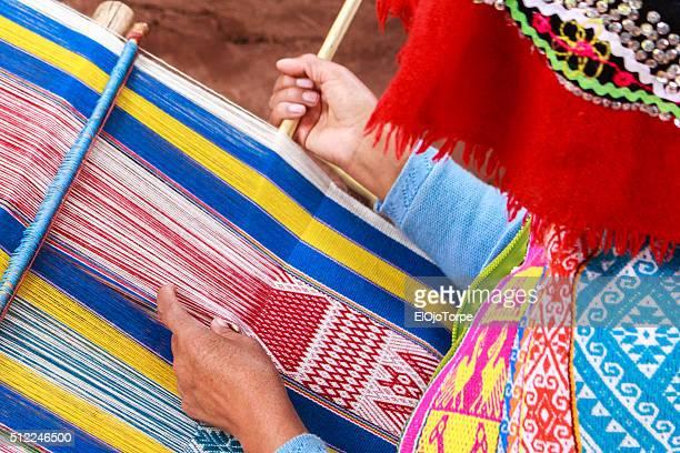Peruvian woman weaving, sacred valley, Peru