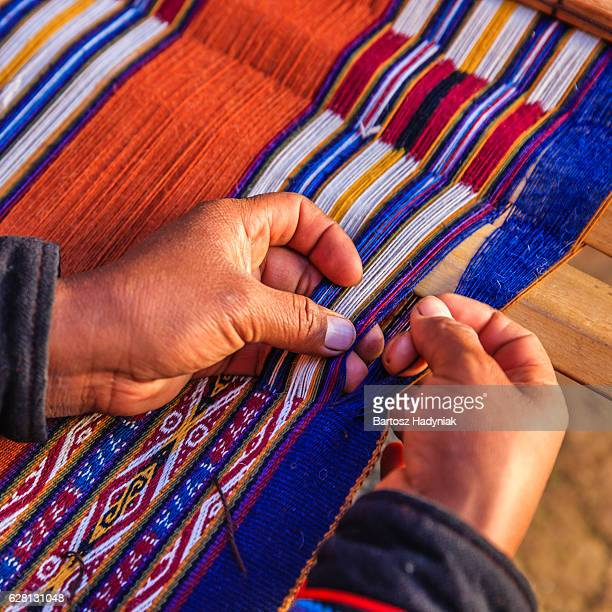 peruvian woman weaving, the sacred valley, chinchero - woven stock photos and pictures