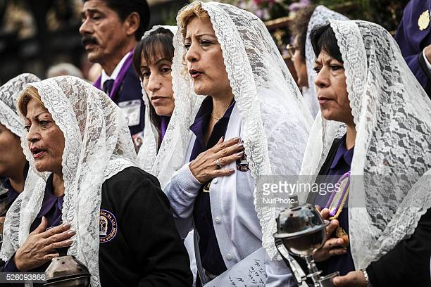 Peruvian women known as quotSahumadorasquot walk backwards as they carry incense burners while participating in a procession honoring Peru's most...