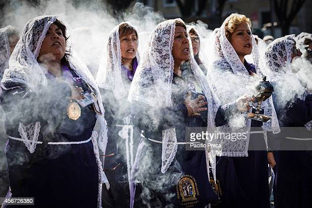 Peruvian women known as Sahumadoras burn incense while participating in a procession in Rome honoring Peru's most revered Catholic religious icon the...