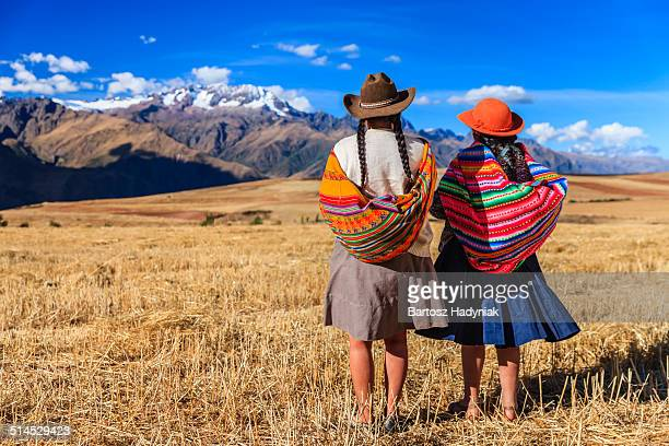 Peruvian women looking at Andes